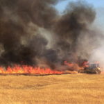 Large field fire and equipment