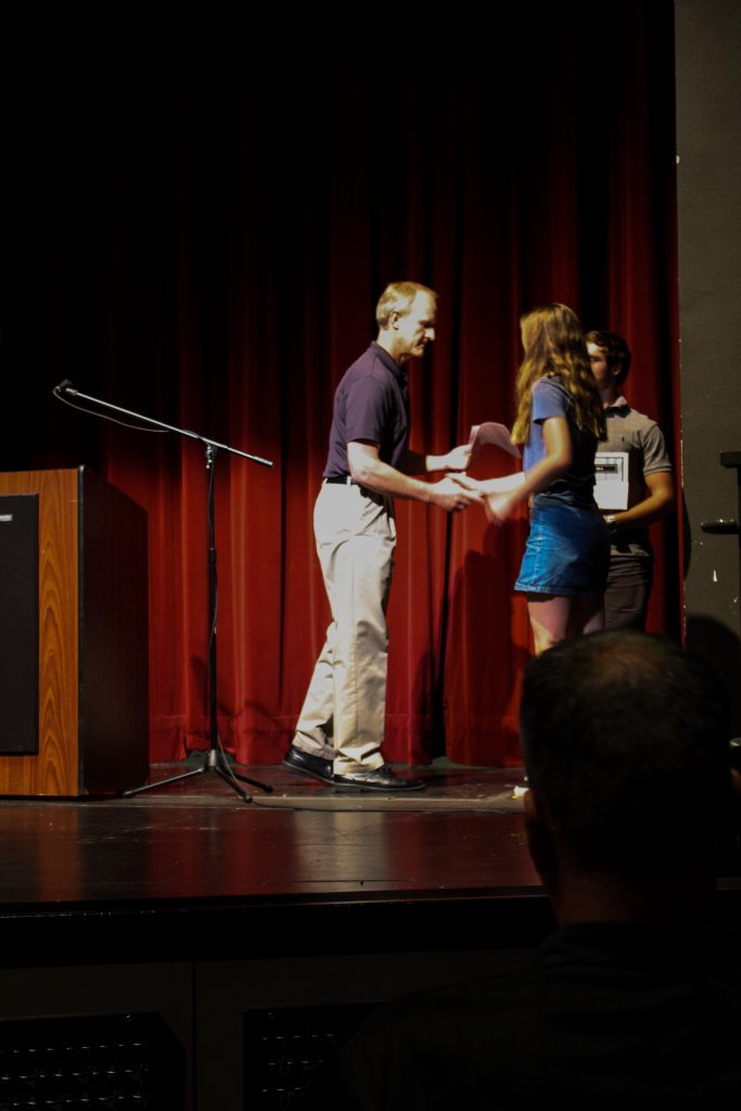 Girl receiving award on a stage