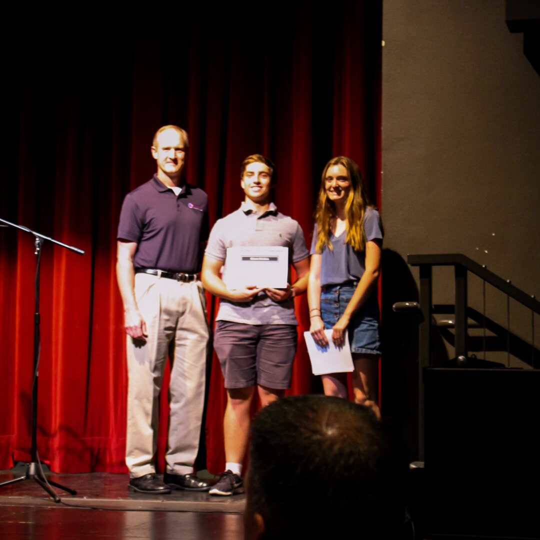 Two students receiving scholarships from the BCFBF on stage
